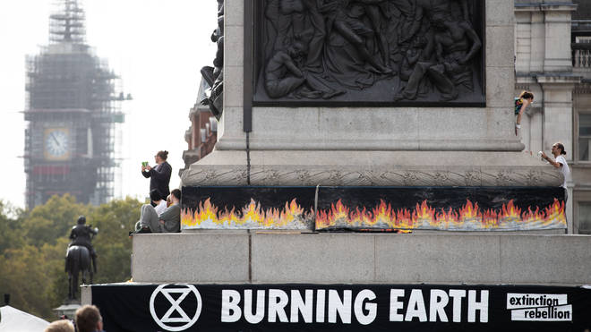 "An Extinction Rebellion banner in London&squot;s Trafalgar Square warns about a ""burning Earth"""