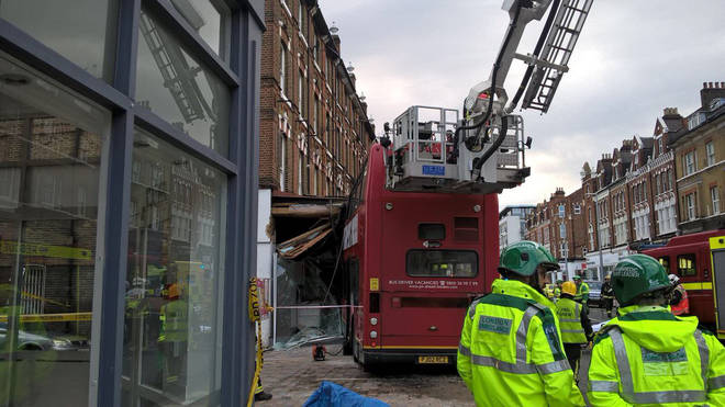 Fire Brigade work to free two people trapped on the bus