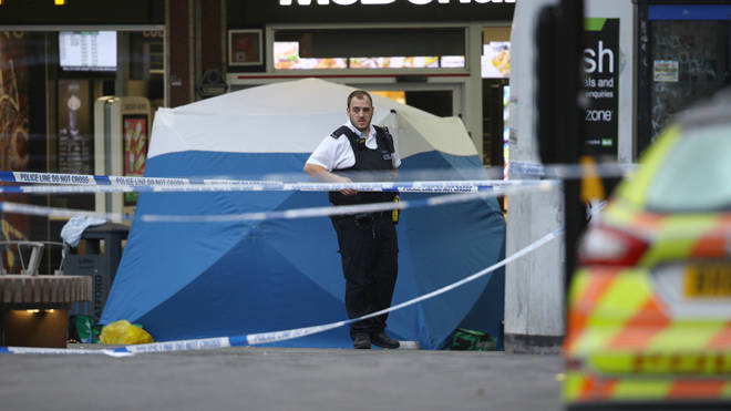 Police at the scene of the fatal stabbing in Stratford
