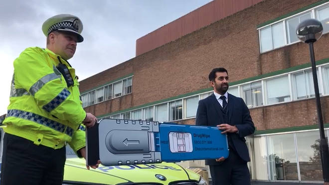 Justice Secretary Humza Yousaf and Ch Supt Stewart Carle welcome the new roadside drug testing kits