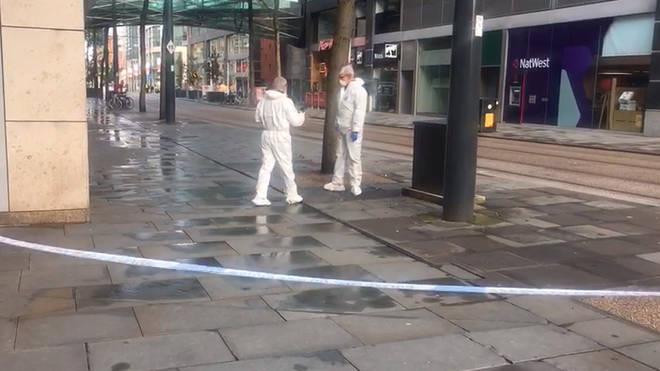 Forensic officers in Manchester where the attack took place