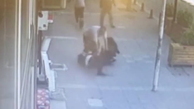 The domestic abuser was tackled to the floor with  a flying headbutt