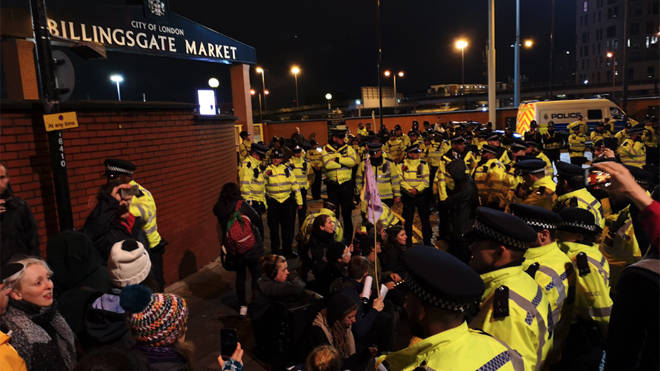 Police and protesters at the scene at Billingsgate Fish Market