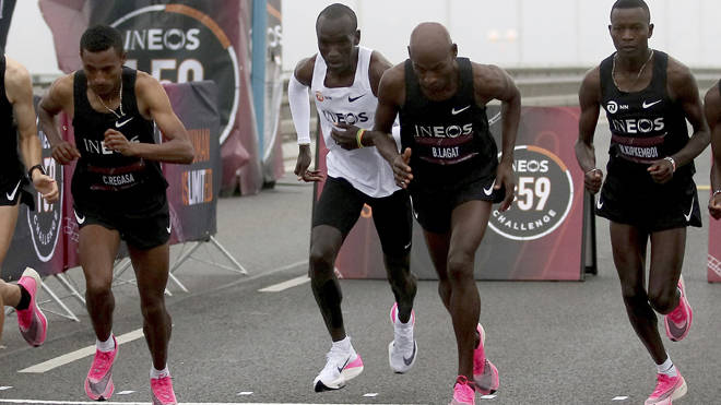 Eliud Kipchoge with pace setters on the start line of his historic effort in Vienna