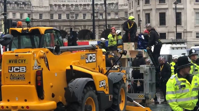 Video Shows Digger Removing Extinction Rebellion Protesters From Structure