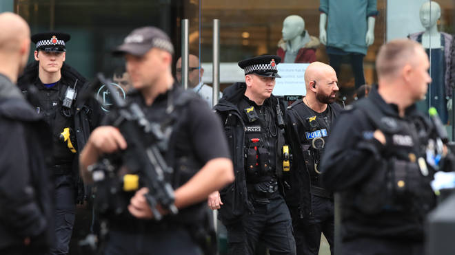 Armed police at the shopping centre yesterday