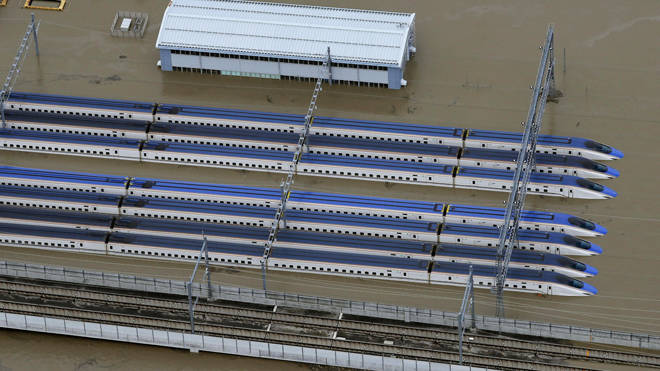 Bullet trains in a flooded depot in Nagano
