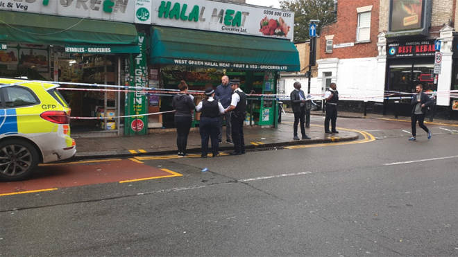 Police at the scene of the double stabbing in Tottenham