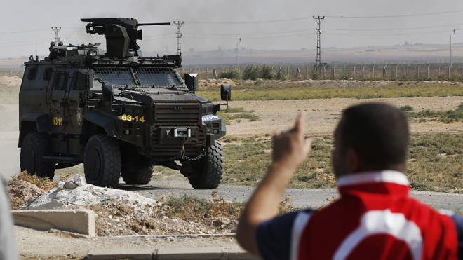 A Turkish police armoured vehicle patrols the border between Turkey and Syria,