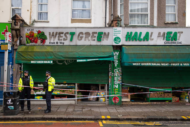 Police outside the West Green Halal Meat butcher's shop on West Green Road, Tottenham, London, following an incident where two men were stabbed and a third man was assaulted.