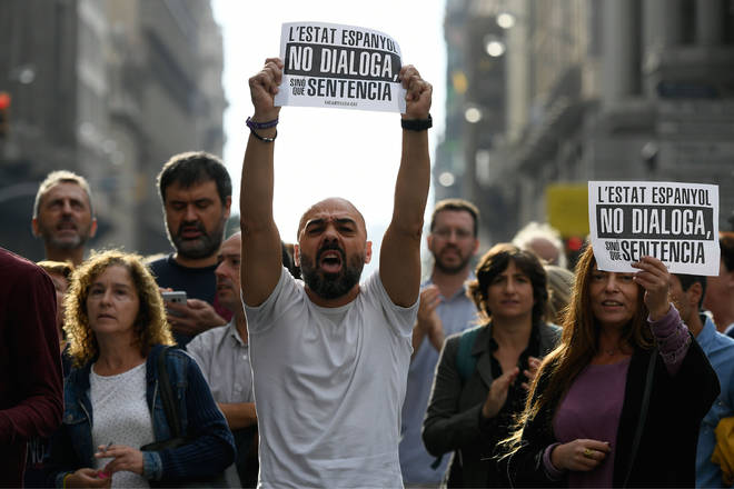 "People protest holding placards reading ""Spanish State does not dialogue, it sentences"" in Barcelona on October 14, 2019, after Spain&squot;s Supreme Court sentenced nine Catalan leaders to prison terms"