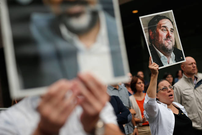 A woman holds a placard with a picture of jailed Catalan separatist leader Oriol Junqueras in Barcelona