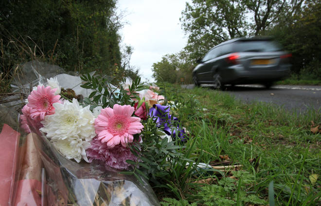 Floral tributes lay on the roadside near RAF Croughton in Northamptonshire on October 10, 2019, at the spot where Harry Dunn was killed as he travelled along the B4031 on August 27