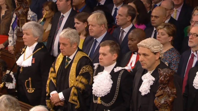 Boris Johnson, MPs and Commons officials listen to the Queen's Speech