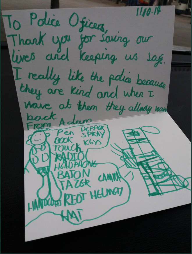 The handwritten note was left on the windscreen of a police van