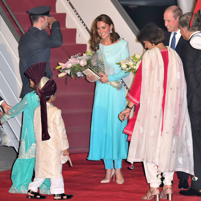 The Duchess of Cambridge was handed flowers by a young girl