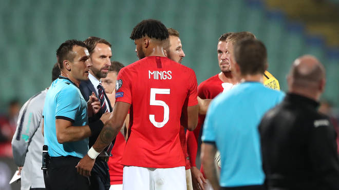 Referee Ivan Bebek talking with England defender Tyrone Mings and manager Gareth Southgate
