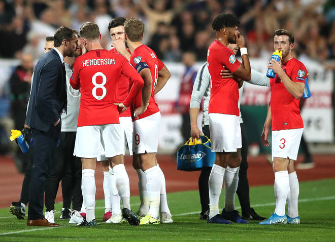 England manager Gareth Southgate (left) speaks to the players with regards to racist chanting from fans during the UEFA Euro 2020 Qualifying match