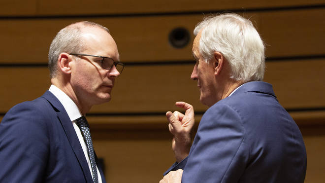 European Union chief Brexit negotiator Michel Barnier, right, speaks with Irish Foreign Minister Simon Coveney, left.
