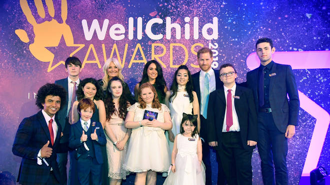 The Royal couple pose with the WellChild Award winners