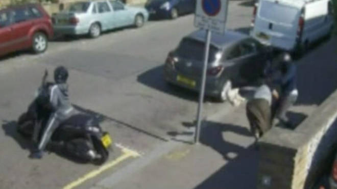 CCTV footage shows the moped gang attacking a 52-year-old woman