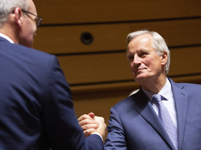Michel Barnier shakes hands with Ireland's Foreign Secretary Simon Coveney
