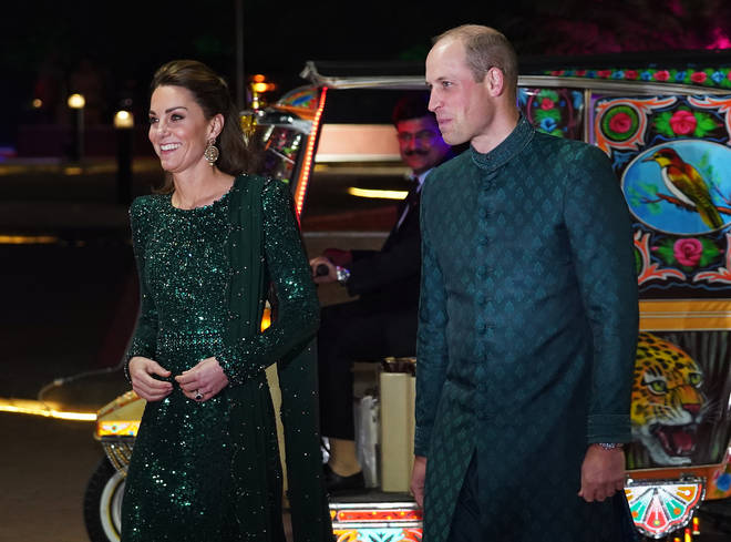 William wears a traditional coat in Pakistan
