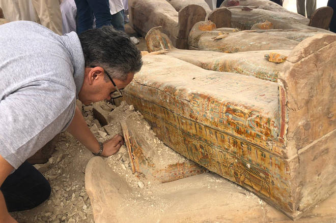 Antiquities minister Khaled El-Anany seen inspecting the finds