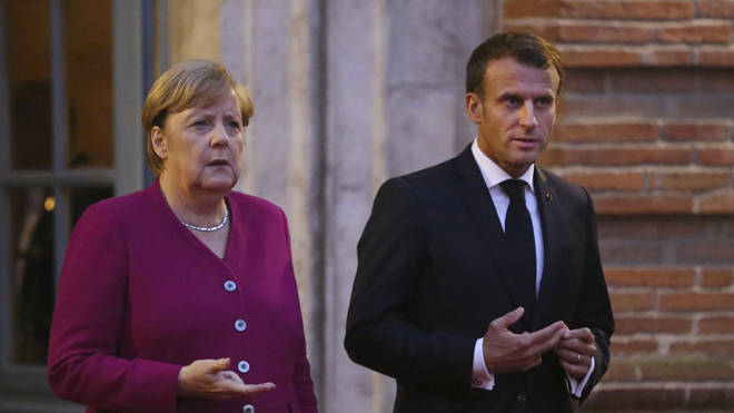 Emmanuel Macron, pictured with Angela Merkel, said he had 'hope' over a possible deal