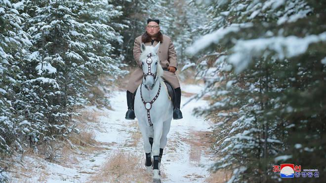 He rode the white horse to climb Mount Paektu in North Korea