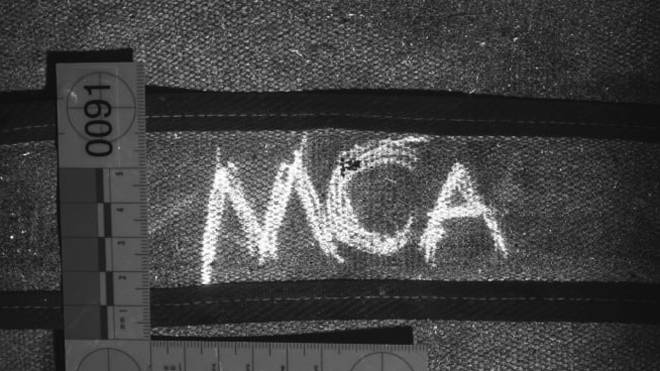 The MCA marking found on the strap of his rucksack
