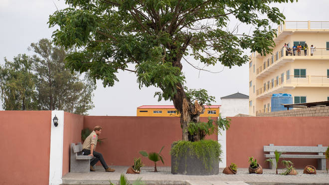 The Duke of Sussex sits alone beneath the Diana Tree in Huambo, Angola