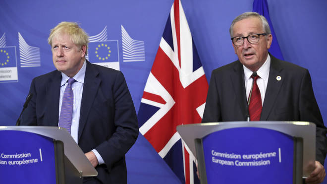 Mr Johnson pictured with European Commission President Jean-Claude Juncker