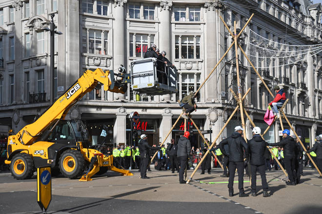 Protesters block the road at Oxford Circus during an Extinction Rebellion climate change protest