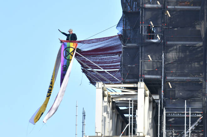 The protester has climbed the scaffolding around Big Ben dressed as the PM