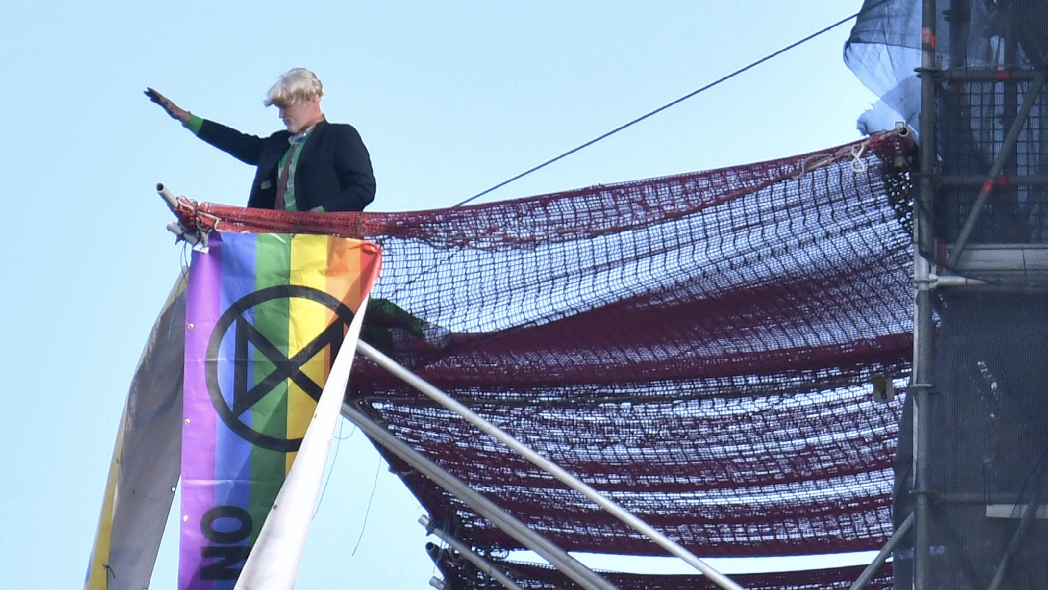 Extinction Rebellion Protester Climbs Big Ben Dressed As Boris Johnson