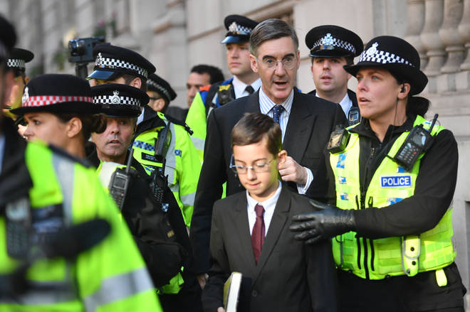 Jacob Rees-Mogg And Son Escorted By Police Through Anti-Brexit Rally