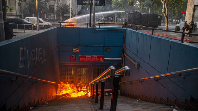 Students set some subway stations alight in the Chilean capital