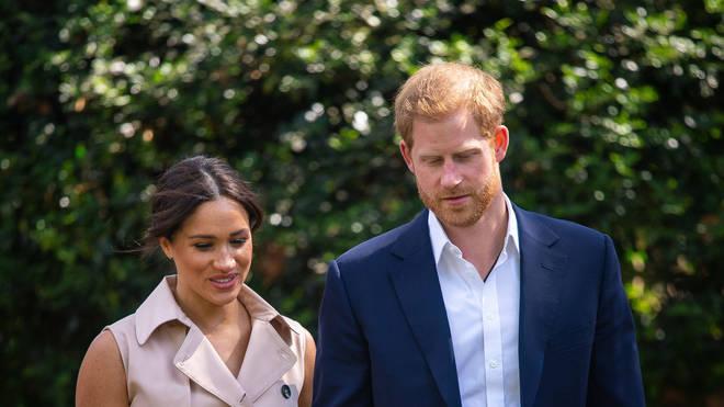 Harry and Meghan walk alongside each other