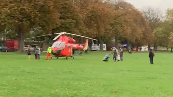 The air ambulance is seen at the scene of a triple stabbing in Peckham Rye