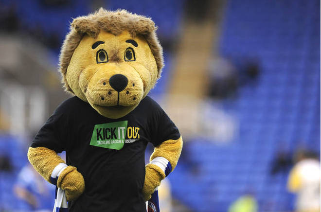 Reading club mascot Kingsley Royal wears a 'Kick It Out' shirt during the pre match warm up.