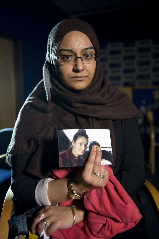 Shamima Begum's sister Renu holds a photo of her sibling