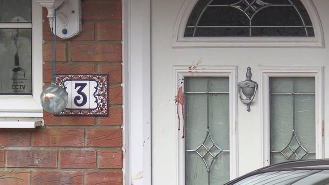 Blood seen on the front door of the home in Milton Keynes