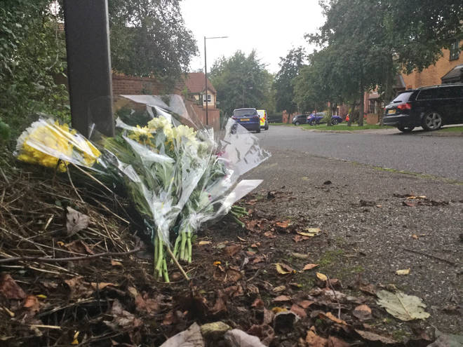 Flowers seen at the scene in Emerson Valley, Milton Keynes
