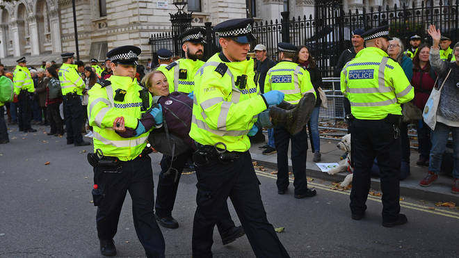 Police carry away an Extinction Rebellion protester