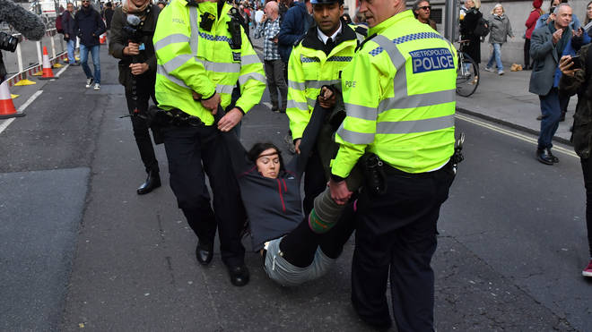 Another protester is arrested by police