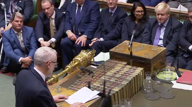 Boris Johnson listens to Jeremy Corbyn in the House of Commons