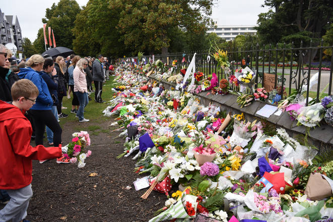 Flowers are placed by people to mourn the victims of the attacks on two mosques in Christchurch, New Zealand
