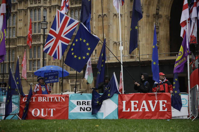 Banners by pro-Brexit leave the EU supporters backdropped by the Houses of Parliament