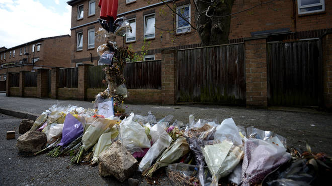 Tributes at the scene in Hackney where Abraham was shot dead